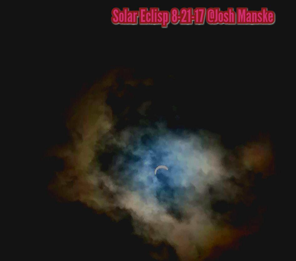 Solar eclipse over Bigfork. Shot using the darkest filter on Galaxy phone