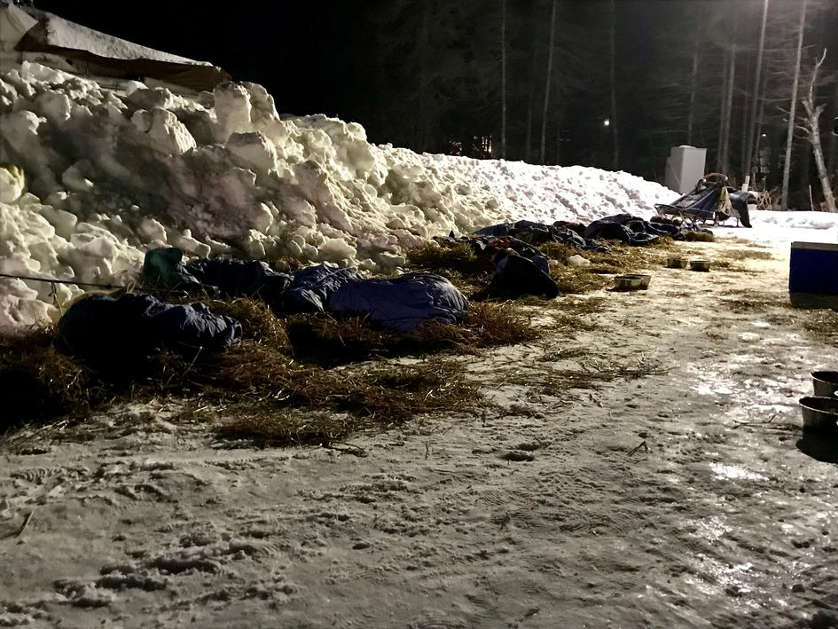 8 Hours Rest: Ryan Anderson's team asleep under blankets at Grand Portage Checkpoint
