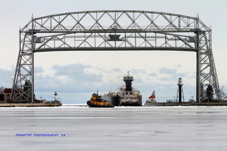The Erie Trader/Clyde S. VanEnkevort heads under the Lift Bridge for the start of the shipping season