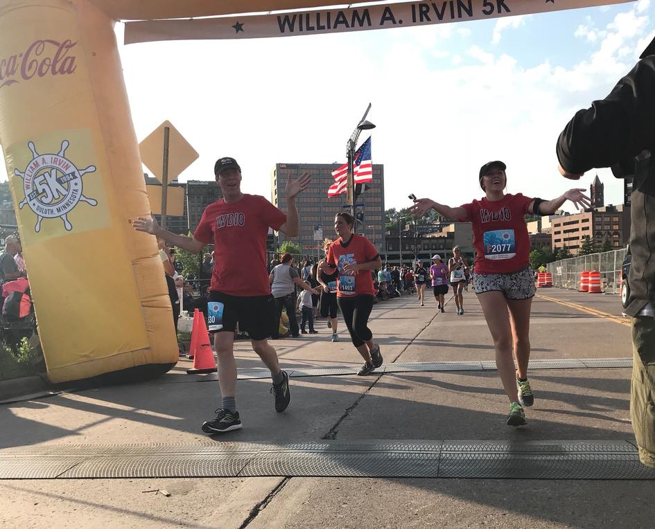 Eyewitness News anchor Darren Danielson and Reporter Baihly Warfield cross the finish.