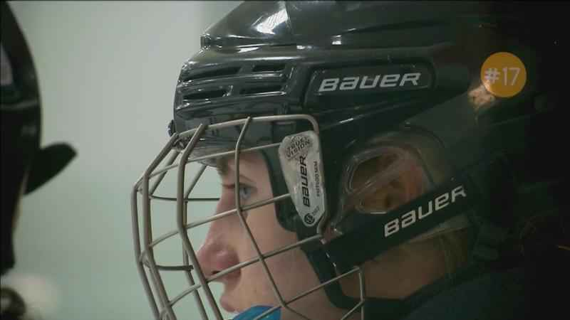 The Eveleth-Gilbert girls hockey wears a #17 sticker on their helmet after losing their teammate.