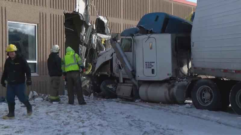 Four people were injured when a semi-truck crashed into a school in Lyle, Minn., on Tuesday morning.