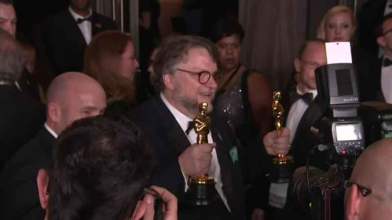 Guillermo del Toro holds his Oscars for best picture and best director after the 90th Academy Awards on Sunday night.