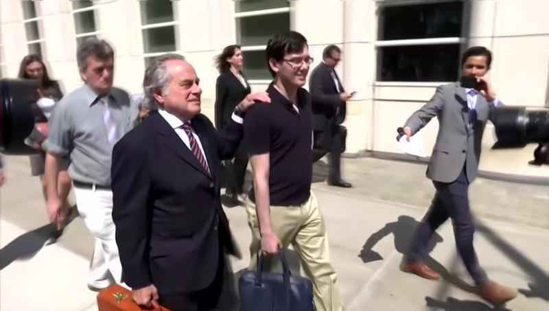 Martin Shkreli, seen walking with his attorney in a file photo, has been ordered to forfeit millions of dollars in assets.