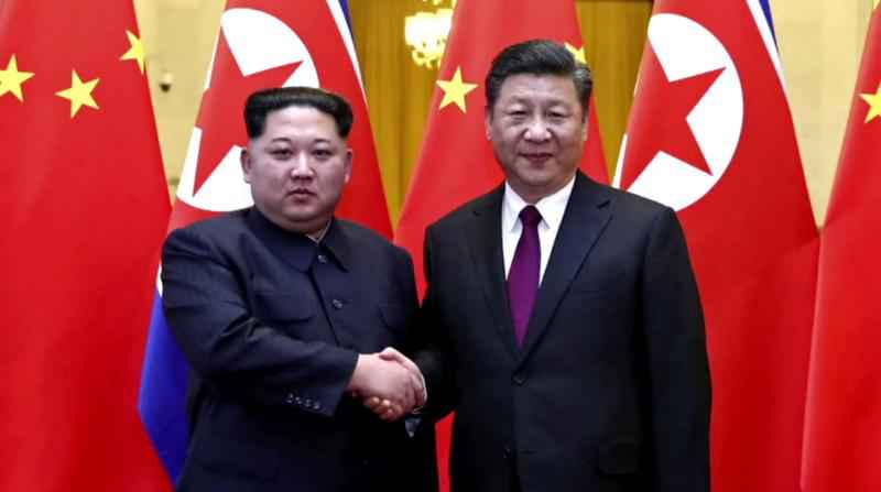 Kim meets Xi, pledges denuclearisation