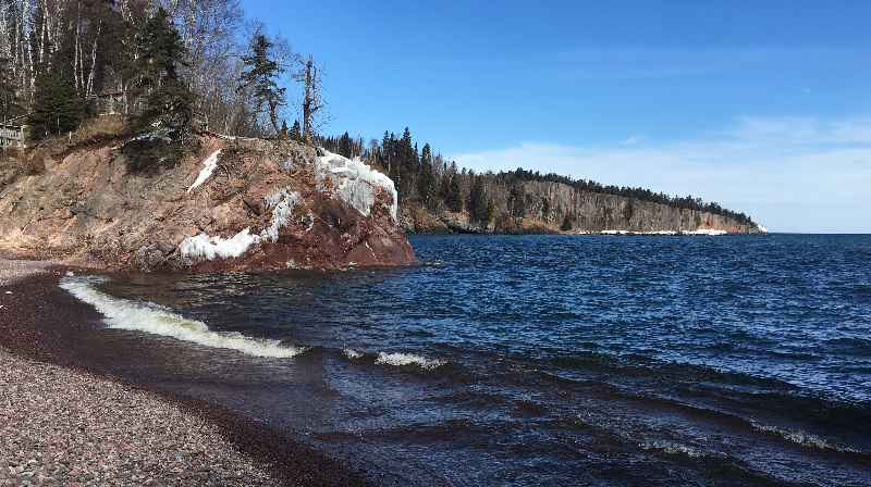 The water level on Lake Superior, seen at Tettegouche State Park in March, has declined from near-record levels.