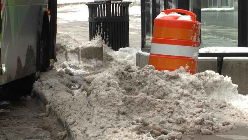 Snow covers parts of Superior Street where construction was supposed to begin Monday.