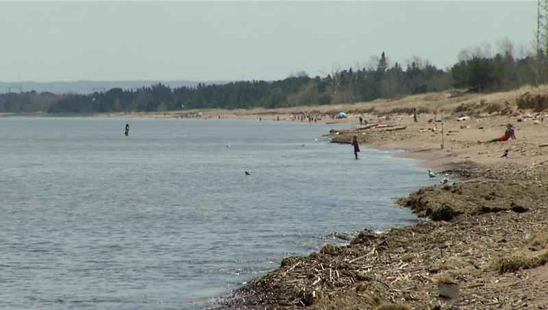People tested the waters of Lake Superior at the Park Point beach as Duluth set a new record high Wednesday.