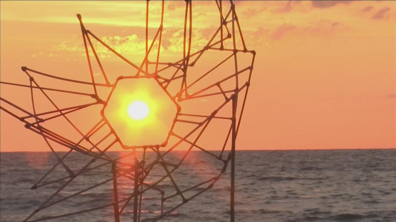 Community members joined a local artist who captured the sunrise of summer solstice with his unique art.�