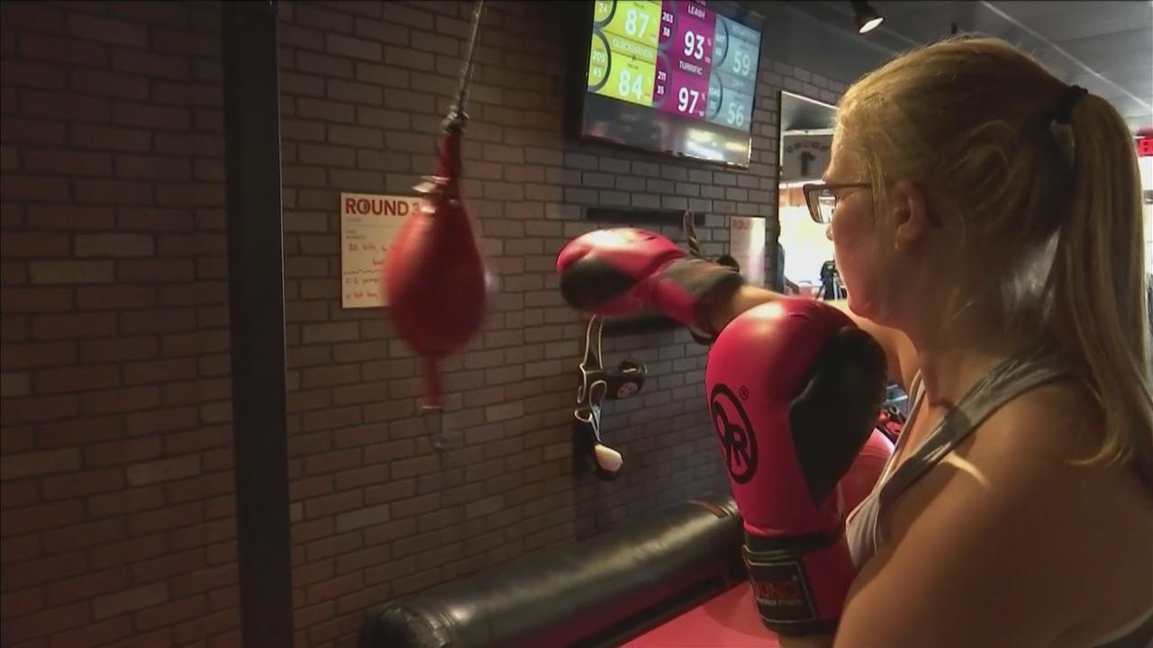 Paige Turri throws a punch during a kickboxing workout at 9Round.