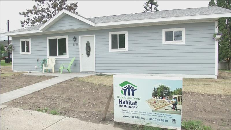 Karen Kniefel and her family celebrated the official dedication of their new home alongside Habitat for Humanity on Sunday.