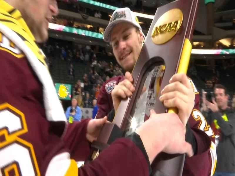 Louie Roehl and Nick Swaney hold the NCAA Title Trophy.