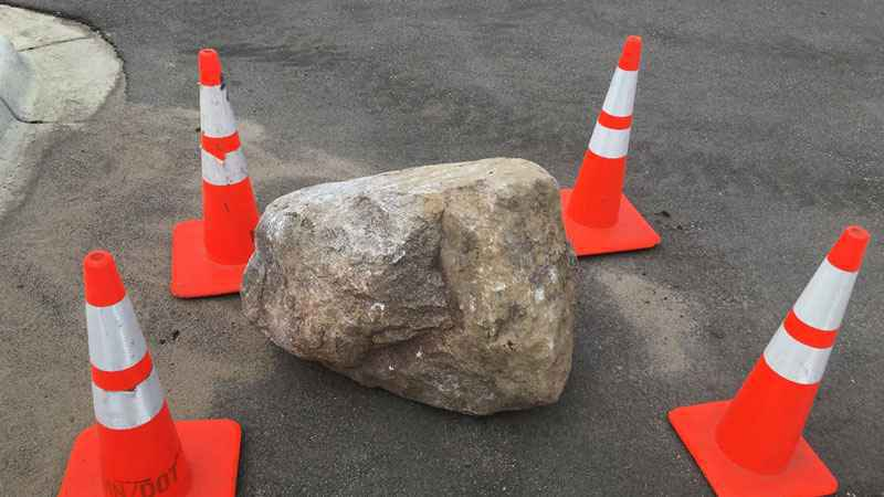 This boulder fell off a truck and struck a car in a Twin Cities suburb, killing two people.