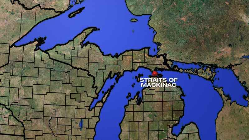 A state report says a leak from an oil pipeline under the Straits of Mackinac could cost nearly $2 billion.