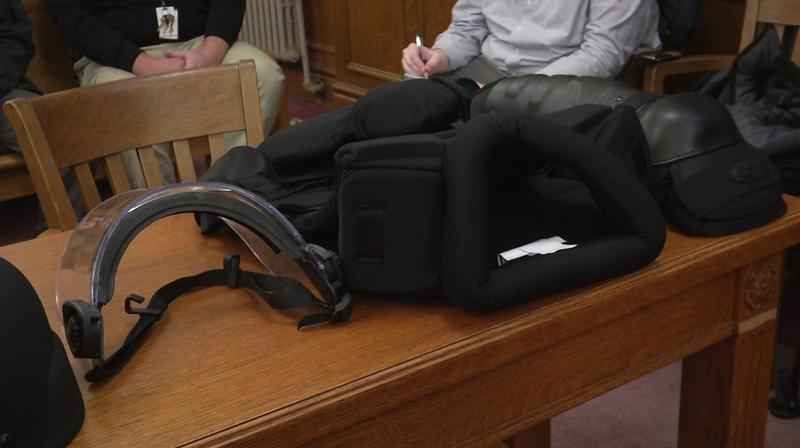 Examples of PPE sit on a table during a public hearing in March.