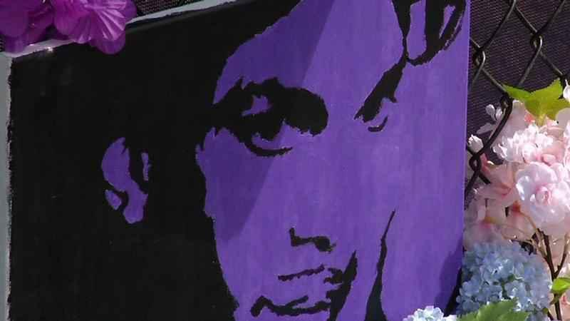 A painting of Prince was displayed outside Paisley Park in Chanhassen following his death. Fans are calling for a grand jury investigation.
