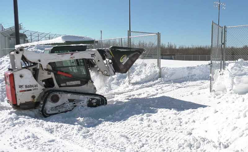 Snow removal at Egerdahl field in Proctor, to make way for spring sports.