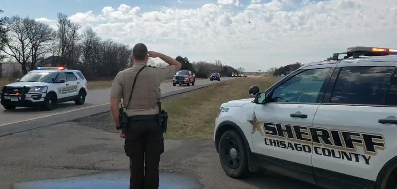 Multiple agencies escorted fallen conservation officer Eugene Wynn home to Pine County on Sunday morning.