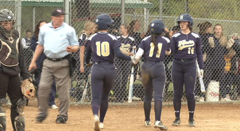 Hermantown celebrates after Jacie Clusia sends two runners home.