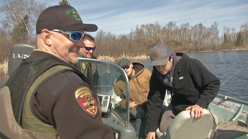 DNR Conservation Officers checked a boat on Fish Lake on the opening day of the Minnesota Fishing season.