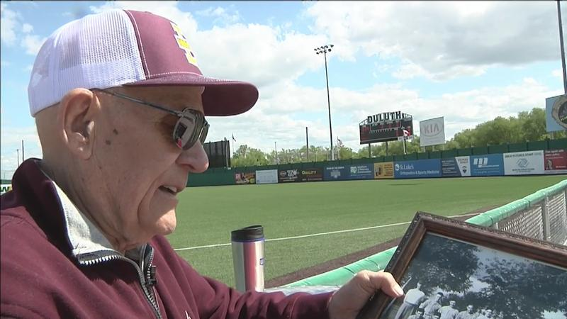 Jim Hill of Duluth shows off a picture of the 1950 Duluth Denfeld State Championship Baseball Team. He was a junior third baseman on the team. His brother also played on that squad.