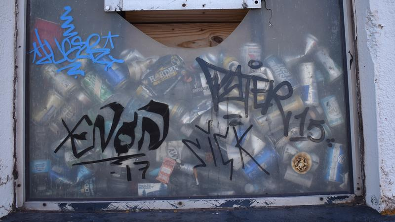 Beer cans are seen in the window at the Superior Entry Lighthouse in June 2019.