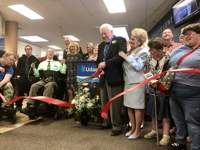 Joe Bullyan cuts the ribbon at Udac's new campus. He and his wife Nancy donated $3 million to make the building possible.