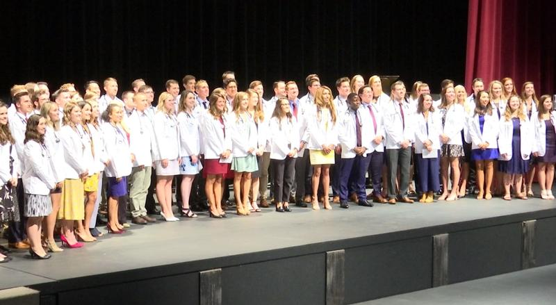 65 students received their white coats on Friday with a record number of them being Native Americans. The white coats symbolize the start of the students pursuing their doctorate degrees.