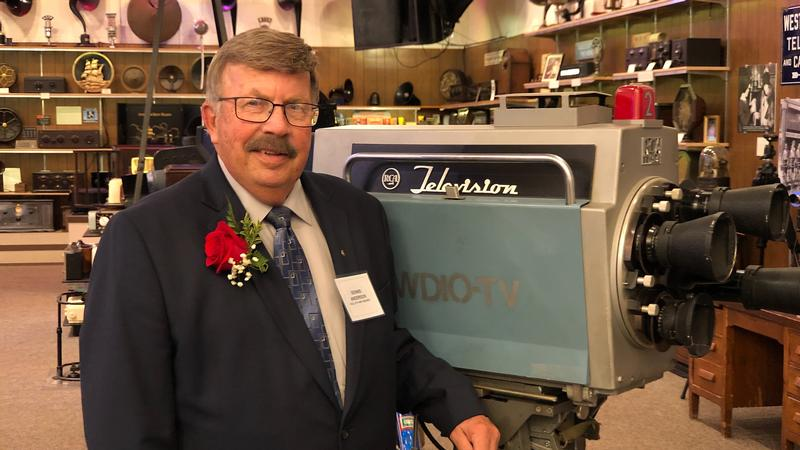 Dennis Anderson poses next to a vintage WDIO-TV camera at the Pavek Museum of Broadcasting.