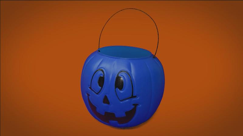blue buckets used by trick-or-treaters to promote autism awareness.