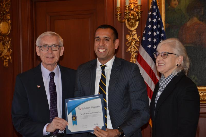 Alumni, Stefan Fletcher accepted the award for UW-Superior. He was joined by Governor Tony Evers and Wisconsin Department of Veterans Affairs Secretary Mary Kolar.
