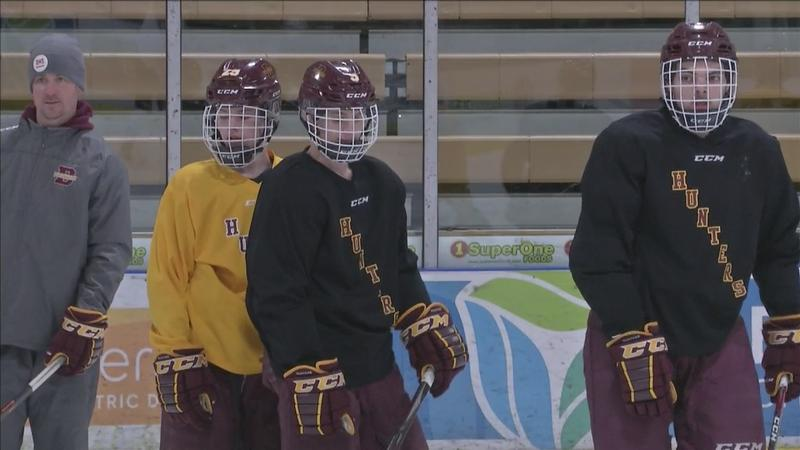 Ryan Geris (left) watching and running drills during a Duluth Denfeld boys hockey practice.