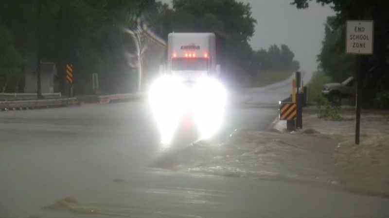 Flash flooding covered roads in Baldwin, Wis., on Monday morning.
