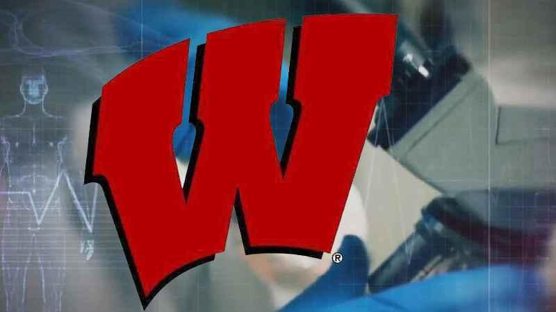 Two University of Wisconsin athletes test positive for virus after returning to campus for voluntary workouts.