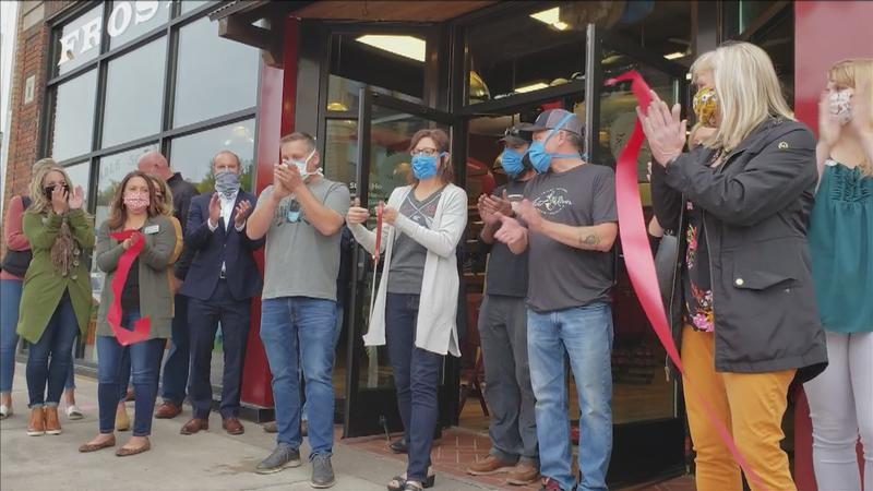 The ribbon cutting for the grand reopening of Frost River Trading Co. in Lincoln Park.