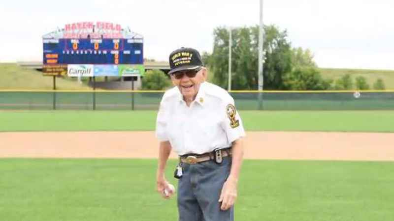 Private First Class Mickey Nelson, a 100-year-old World War II veteran, prepares to throw the ceremonial first pitch for the Minnesota Twins on Sunday, Sept. 6, 2020.