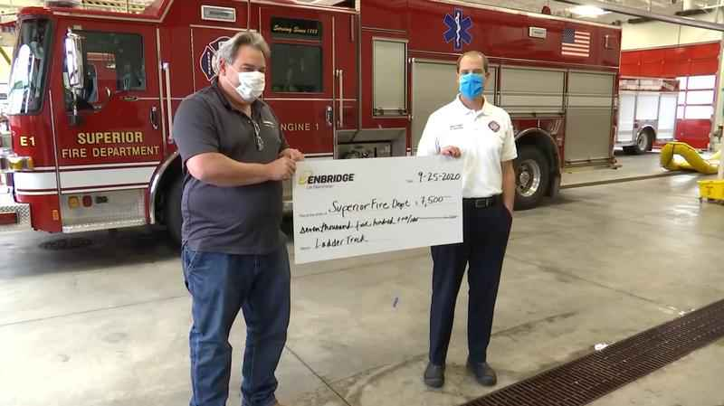Enbridge donates to Superior Fire Department to help purchase new ladder truck.