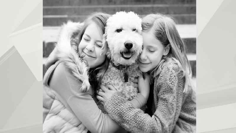 Paige and her sister Emily Moore pictured with their family dog, Frankie.
