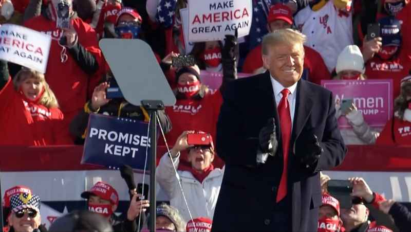 President Donald Trump thanking supporters at a rally in Green Bay Friday.