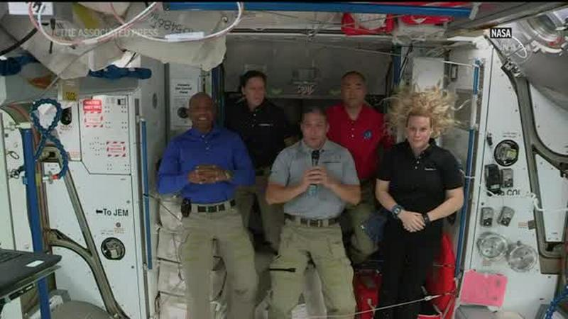 SpaceX crew astronauts discuss journey to ISS