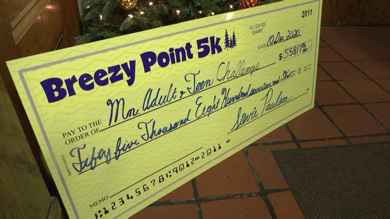 Breezy Point donated a check totaling $58,813 they raised from their 12th annual 5K race to the Minnesota Adult and Teen Challenge.