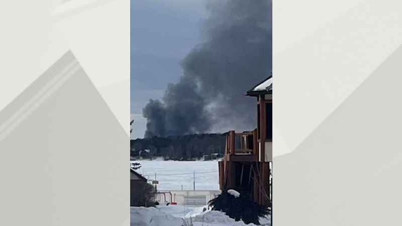 Smoke from the garage fire could be seen from Pike Lake.