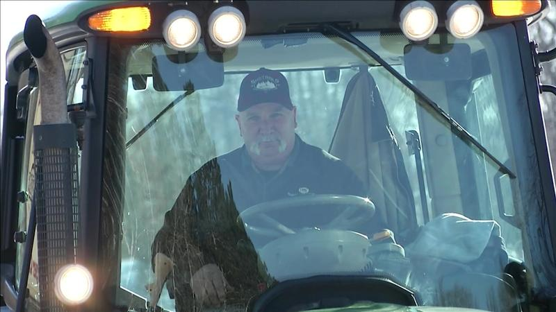 Driver Tom Witte sits in the cab of a Sno Trails groomer outside of the Trailside Inn in Hayward.