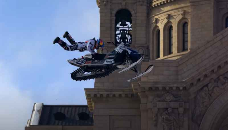 Professional snowmobiler Levy LeVallee performing a snowmobile stunt in St. Paul.