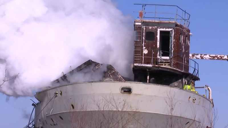 Steam rose from the J.B. Ford as crews worked to put out a fire Monday.