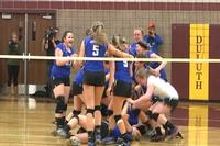 Meredith Sutton #5 celebrates with her team after they clinched a spot in the 2015 State Volleyball Tournament.