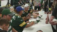 Three current and three former Packers players sign autographs for fans at the Bay Area Civic Center in Ashland.