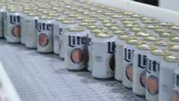 Representatives of beer giant Molson Coors Say newly imposed tariffs on aluminum imports will cost the company hundreds of millions of dollars, and may force it to change its packaging.