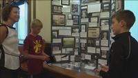 Two young men from Duluth won 1st place at National History Day, and showed their project to Mayor Emily Larson.