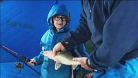 Ollie Perron with his first walleye.